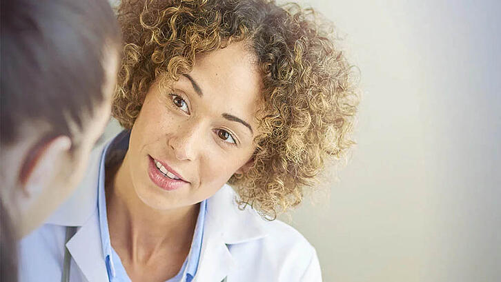 Health care professionals talks to patient